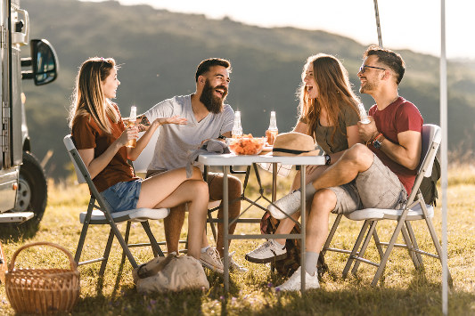 Group of friends with camping table