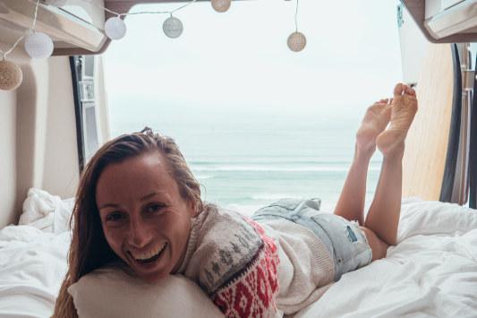 Happy lady in campervan